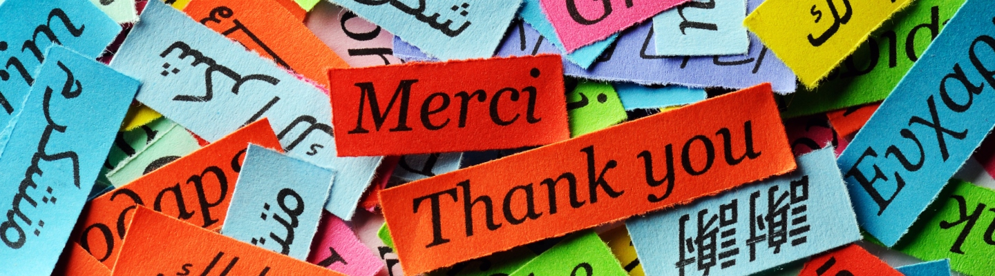 "the word ""thank you"" written in many different languages"