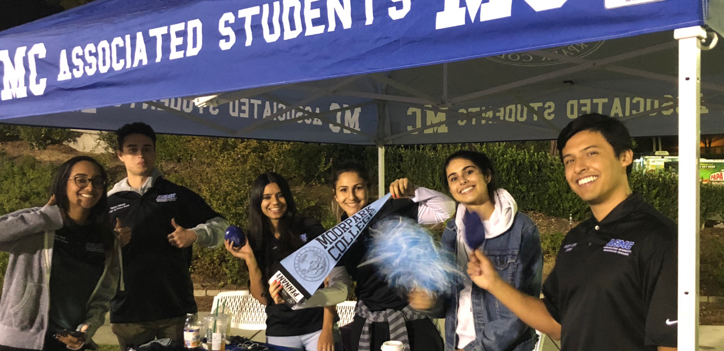 Associated Student Board members promote school spirit at a football game.