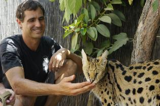 zoo student with serval cat