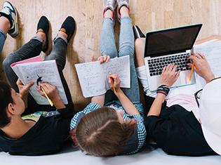 Top view of college students studying together.