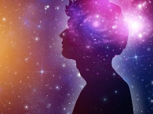 Side view of a person with a backdrop of the galaxy.