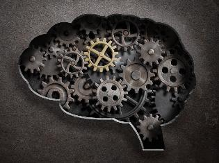 A silhouette of the human brain with cogs and gears filled in it.