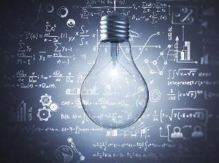 A lightbulb in the foreground with mathematical equations written in the background.